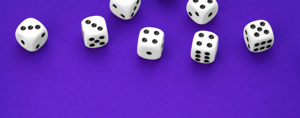 white_dice_on_purple_background